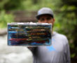 Tacky The Predator Box in hand